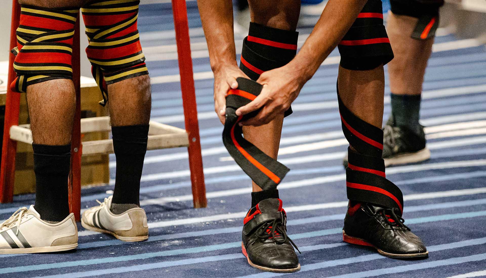Legs, athlete powerlifter in knee wraps.
