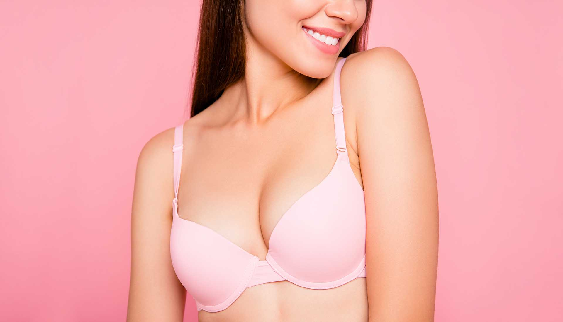 Beautiful woman wearing pink bra.